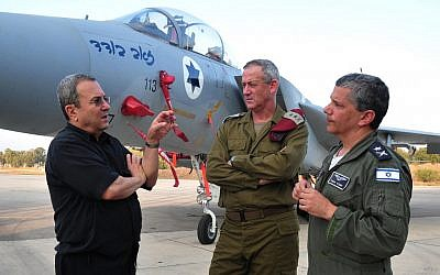 Maj. Gen. Amir Eshel, right, in conversation with IDF commander Lt. Gen. Benny Gantz and former Defense Minister Ehud Barak (photo credit: Ariel Hermoni/DefenseMinistry/Flash90)