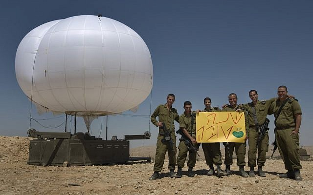IDF soldiers on the Egyptian border with a sign wishing a 'Happy New Year' (photo credit: Tsafrir Abayov/Flash90)