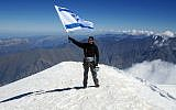 Nadav Ben Yehuda at the top of Mount Kazbeck on Thursday. (Anna Godg'bidzh/ GPO/ Flash90)