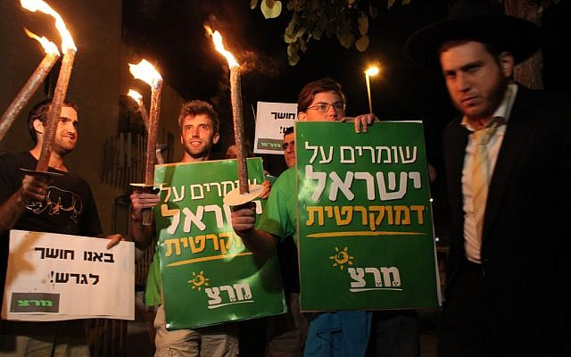 Activists rallying against the time change Saturday night. (photo credit: Yoav Ari Dudkevitch/Flash90)