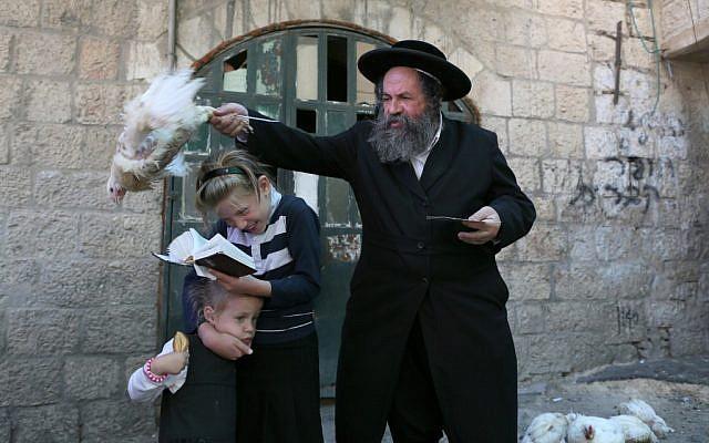 Doing 'kaparot' in Meah Sharim, Jerusalem, on September 23, 2012 (photo credit: Nati Shohat/Flash90)