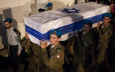 Israeli soldiers carry the coffin of Netanel Yahalomi during his funeral in the Israeli city of Modiin, early Sunday, September 23, 2012. Yahalomi was killed Friday in a shootout between Islamist terrorists and IDF troops along Israel's southern border with Egypt. (photo credit: Yonatan Sindel/Flash90