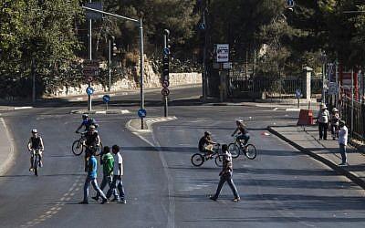 Israelis riding their bikes on the empty streets of Jerusalem on Yom Kippur. (Yonatan Sindel/Flash90)