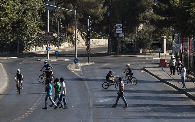 Israelis riding their bikes on the empty streets of Jerusalem on Yom Kippur. (Yonatan Sindel/Flash90)
