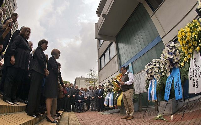 Shay Shapira, son of murdered athletics trainer Amitzur Shapira, right, delivers a speech in front of wreaths at a memorial at the former accommodation of the Israeli Olympic team in Munich, southern Germany, Wednesday, Sept. 5, 2012. (photo credit: dapd, Joerg Koch/AP)