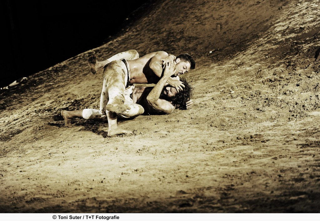 """Neuenschwander, as God, wrestles with Jacob in """"Genesis"""" at the Schauspielhaus (Courtesy of the Schauspielhaus, Zurich)"""