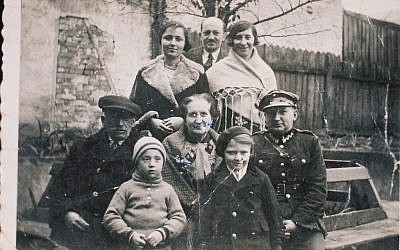 Illustrative: The family of Arnold Greenfeld, Hava Shilo's father, is shown in this 1932 image taken next to their home in Lvov. All eight people were killed in the Holocaust. (Courtesy Hava Shilo via JTA)