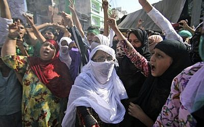 Indian Muslim women shout slogans against the US on Friday during a protest rally, one of many demonstrations around the world against perceived insults to the Prophet Muhammad. (photo credit: AP/Channi Anand)