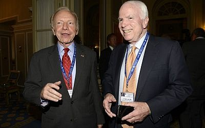 US Senators John McCain, right, and Joseph Lieberman during a meeting on World Economy in Cernobbio, Italy, Friday, Sept. 7 (photo credit: AP/Giuseppe Aresu)