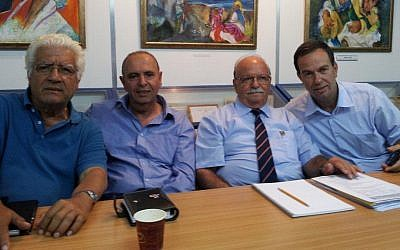 Meir Kahaolon, second from left, president of the World Organization of Libyan Jews, with members Doron Shimon, left, Michael Goren and Zuri Doron Dadosh in the group's offices, May 2012. (photo credit: Courtesy Meir Kahaolon)