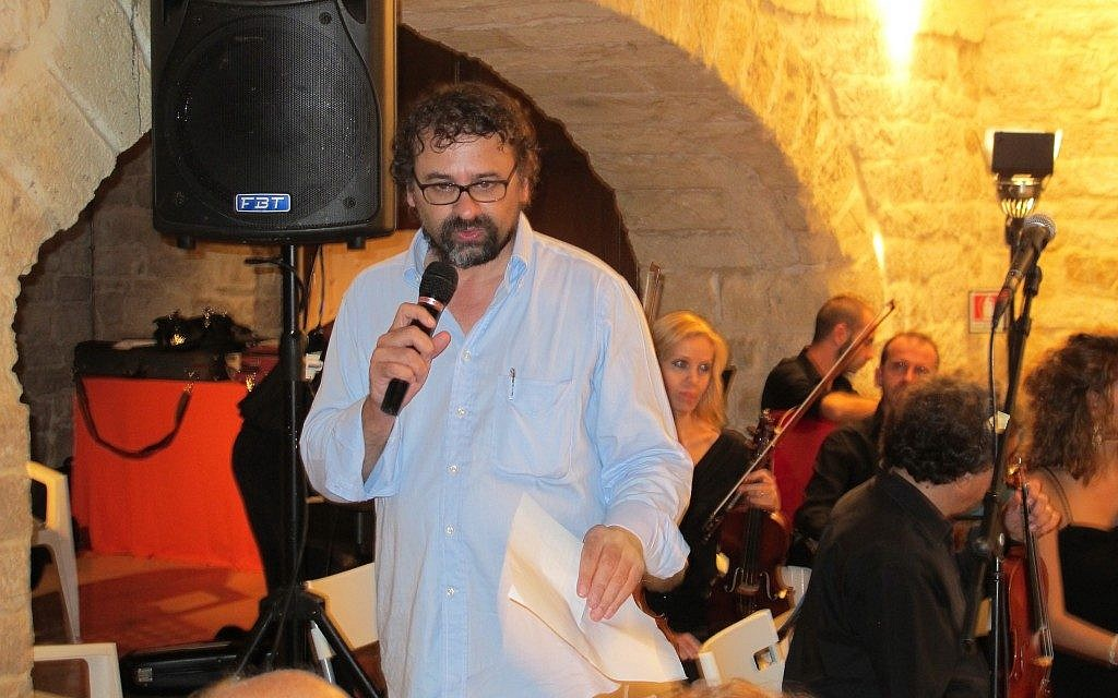 Francesco Lotoro introduces a concert of cabaret music composed in concentration camps, part of the Lech Lecha festival of Jewish culture in Trani, Italy, earlier this month. (Ruth Ellen Gruber/JTA)