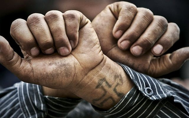 In this April 2006 file photo, Egyptian Copts cross their wrists in defiance outside the Saints Church in the Sidi Bishr district of Alexandria in Egypt. (photo credit: AP/Ben Curtis)