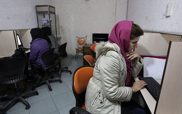 Iranian women use computers at an Internet cafe in central Tehran. (photo credit: AP/Vahid Salemi)