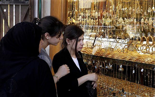 Iraqi woman look at jewelry at a marketplace in Kazimiyah neighborhood, northern Bagdad on Sunday, Sept 2 (photo credit: AP/Karim Kadim)