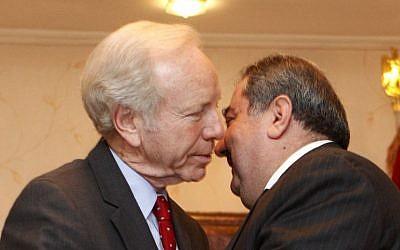 US Senator Joe Lieberman, left, greets Iraqi Foreign Minister Hoshyar Zebari in Baghdad in 2012 (photo credit: AP/Karim Kadim)