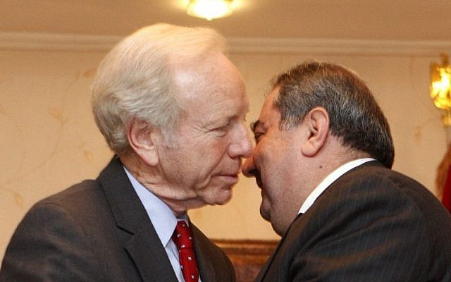 US Senator Joe Lieberman, left, greets Iraqi Foreign Minister Hoshyar Zebari in Baghdad in 2012 (photo credit: AP/Karim Kadim)