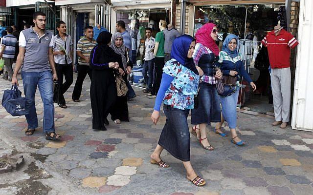 Iraqis shop at a marketplace in northern Baghdad's Kazimiyah neighborhood on Sunday, September 2 (photo credit: AP/Karim Kadim)