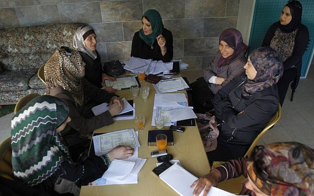 "Women in the ""By Participating, We Can"" group meeting last week. (photo credit: AP/Nasser Shiyoukhi)"