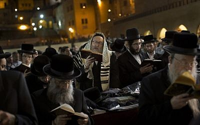 Ultra-Orthodox Jews pray at the Western Wall in Jerusalem's Old City, before the start of the holiday of Rosh Hashanah on Sunday. (photo credit: AP/Bernat Armangue)