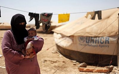 Syrian refugees at Zaatari Refugee Camp in Mafraq, Jordan, in early September (photo credit: AP/Mohammad Hannon)