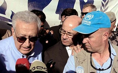 Lakhdar Brahimi (left) during his visit to the Zaatari refugee camp in Jordan, September 18 (photo credit: AP/Raad Adayleh)
