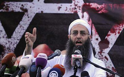 Sunni hardline preacher Sheikh Ahmad Assir speaks during a protest against an anti-Islam movie, in Beirut, Lebanon, Friday. (AP Photo/Ahmad Omar)