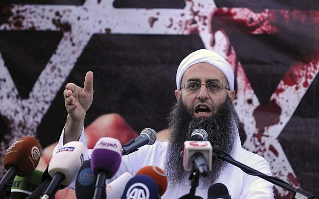 Sunni hardline preacher Sheikh Ahmad Assir speaks during a protest against an anti-Islam movie, in Beirut, Lebanon, Friday. (AP Photo/Ahmad Omar)