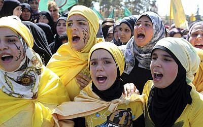 Lebanese girls chant slogans during a protest about a film ridiculing Islam's Prophet Muhammad in Lebanon's eastern city of Baalbek, Lebanon, Friday, Sept. 21, 2012. (AP Photo/Bilal Hussein)