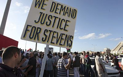 Libyans protest against Islamic militias in Benghazi, a week after the attack on the US Embassy that killed Ambassador Chris Stevens and three others in September 2012. (photo credit: AP /Mohammad Hannon)