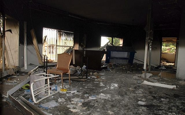 Glass, debris and overturned furniture are strewn inside a room in the gutted US Consulate in Benghazi, Libya, after an attack that killed four Americans, including Ambassador Chris Stevens, Sept. 12, 2012. (photo credit: AP/Ibrahim Alaguri)