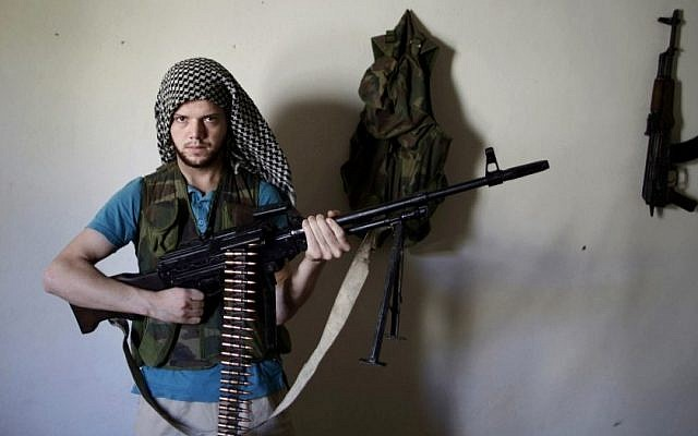A Syrian rebel fighter in Aleppo. (AP Photo/Muhammed Muheisen)