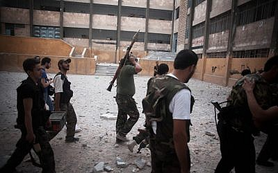 FSA soldiers go to the front line in Izaa district in Aleppo, Syria, Sunday, Sept. 9, 2012 (photo credit: Manu Brabo/ AP)