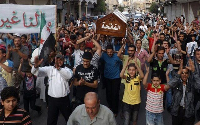 This citizen journalism image provided by Shaam News Network SNN, taken on Friday, Aug. 31, 2012, purports to show the funeral of Ahmed Ismail Zaqzuq, killed in fighting with pro-government forces in Damascus. (photo credit: AP)