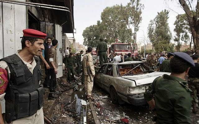 Yemeni soldiers at the site of a car bomb attack in Sanaa', September 11 (photo credit: AP/Hani Muhammad)