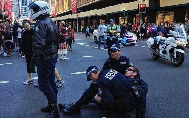 A police officer is injured during a violent demonstration Saturday in central Sydney, Australia (photo credit: Twitter)