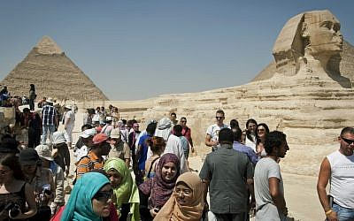 Tourists visit the pyramids in Giza, near Cairo, in 2012. (AP/Khalil Hamra)