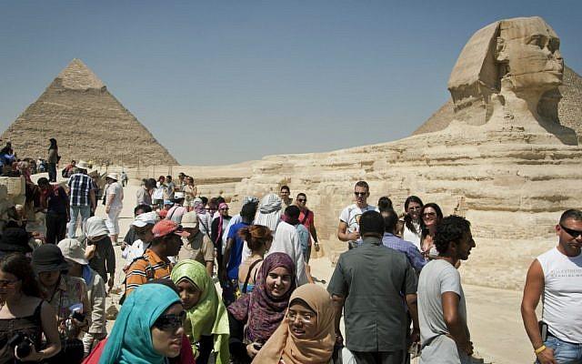Tourists visit the pyramids in Giza, near Cairo, in 2012. (AP/Khalil Hamra)