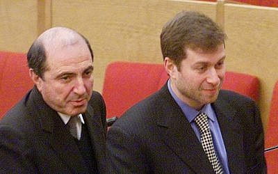 In this Jan. 26, 2000 file photo Russian tycoons Boris Berezovsky, left, and Roman Abramovich, then both lawmakers, walk after the session of the State Duma, parliament's lower house, in Moscow, Russia. (photo credit: AP)