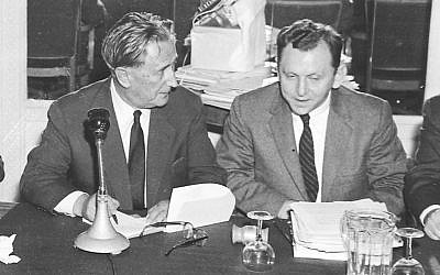 Saul Kagan, the founding executive director of the Claims Conference, right, speaks with Nahum Goldmann, the founder and longtime president of the World Jewish Congress, in 1958. (photo credit: Courtesy Claims Conference via JTA)