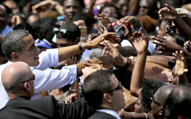 President Barack Obama greets supporters after speaking at a campaign event at Norfolk State University, on Tuesday, in Norfolk, Va. (photo credit: AP Photo/Pablo Martinez Monsivais)