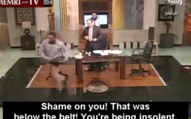 Shi'ite guest Mahmoud flees the Egyptian TV studio (photo credit: Memri)