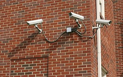 Illustrative photo of three security cameras attached to a building. (photo credit: CC BY-SA 3.0, by Ildar Sagdejev (Specious), Wikimedia Commons)