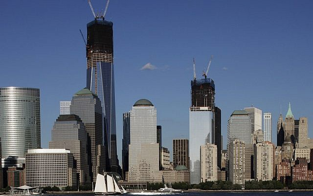 In this file photo of June 23, 2012, construction cranes perch on top of One World Trade Center, left, and Four World Trade Center in New York. (Mark Lennihan/AP)