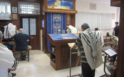 A man prays in a synagogue (Illustrative photo credit: Ben Sales/JTA)