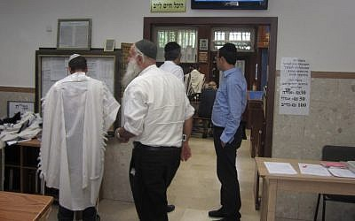 The foyer of the Shtiblach, a round-the-clock synagogue in southern Jerusalem. (photo credit: Ben Sales/JTA)
