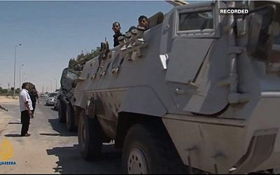 Egyptian armored vehicles in Sinai (photo credit: screen capture AlJazeeraEnglish/YouTube)