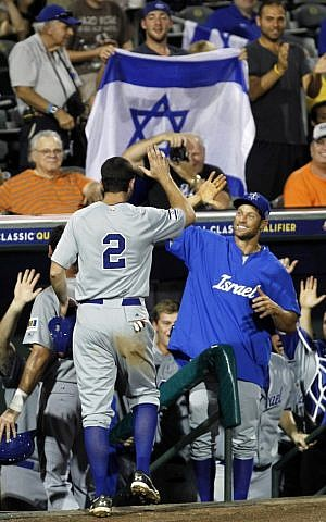 Israel's Josh Satin (2) is congratulated after scoring on a double by Charlie Cutler against South Africa in the eighth inning of a World Baseball Classic qualifier baseball game in Jupiter, Florida, on Wednesday, September 19, 2012 (photo credit: AP Photo/Alan Diaz)