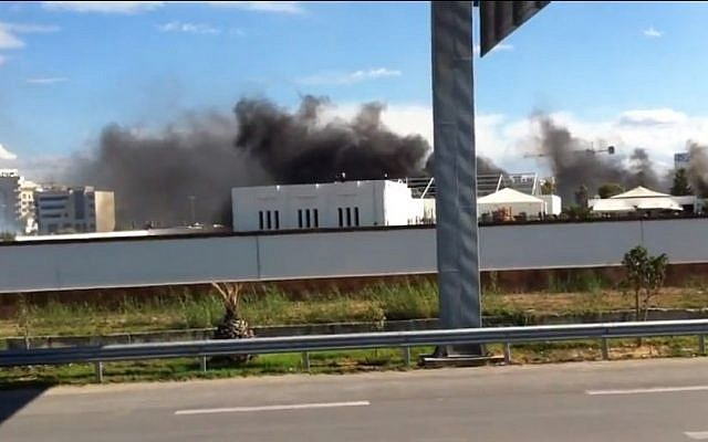Smoke rising over the US embassy compound in Tunis, Tunisia, on September 14 (photo credit: Youtube screen capture)