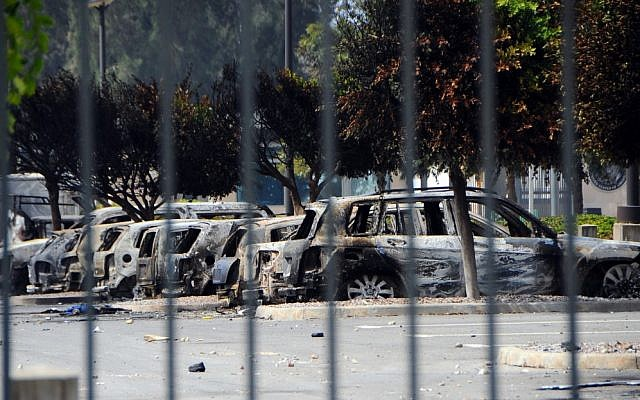 View of several dozen burned cars in the parking lot of the U.S. Embassy, a day after several thousand demonstrators angry over a film that insults the Prophet Muhammad stormed the compound, Tunis, Tunisia, on Saturday. (photo credit: AP/Hassene Dridi)