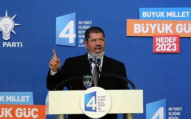 Egyptian President Mohammed Morsi addresses the congress of Turkey's ruling Justice and Development Party in Ankara, Turkey, Sunday, Sept. 30 (photo credit: AP)